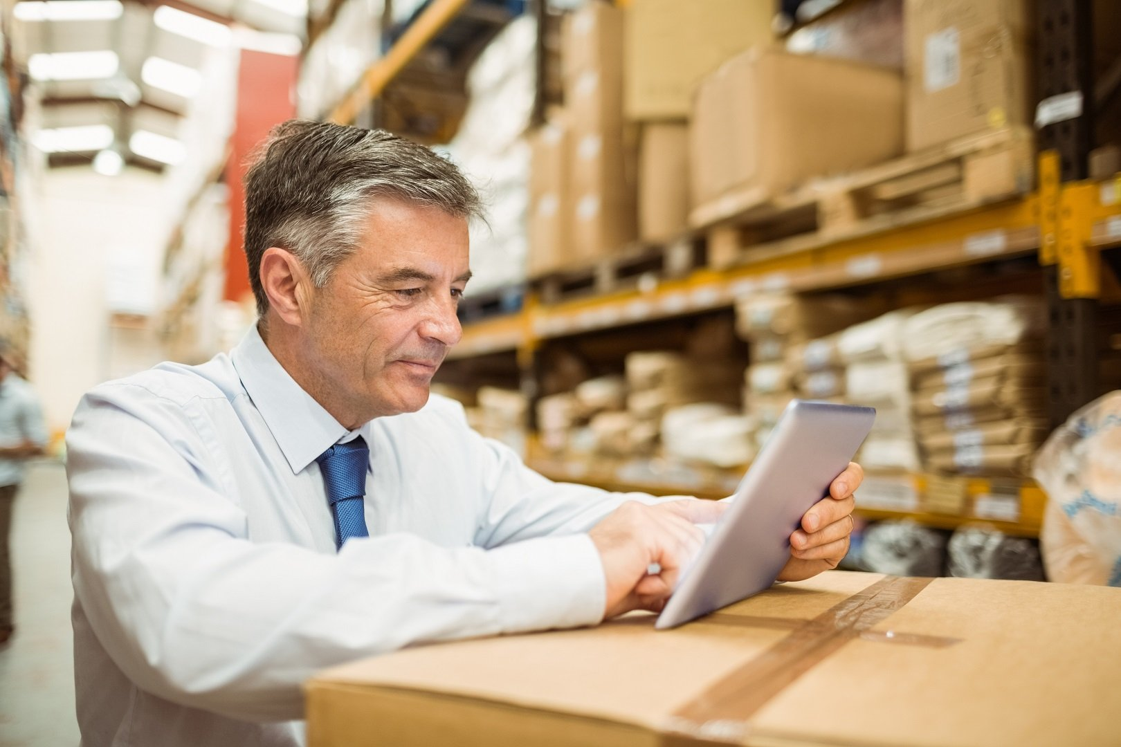 what is industrial property management warehouse manager working on tablet pc